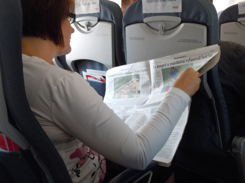 My mother casually reading a Czech newspaper.